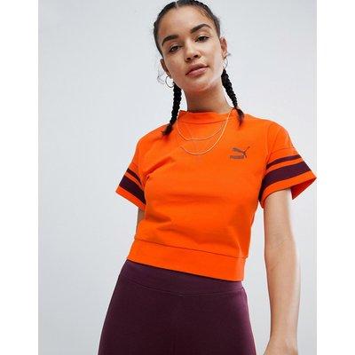 Puma – T-Shirt in Orange mit Zierstreifen