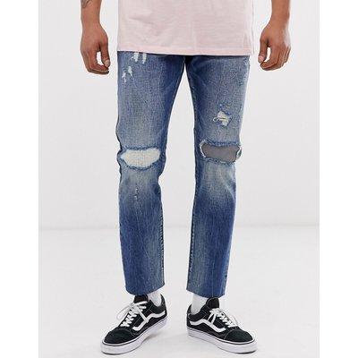 Scotch & Soda – Ralston – Schmale Jeans in regulärer Passform mit Zierrissen-Blau
