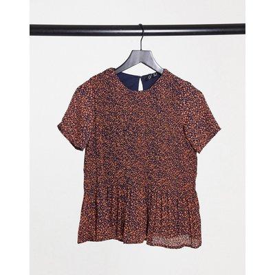 Vero Moda – Bluse mit Schößchen und marineblauem Muster   VERO MODA SALE