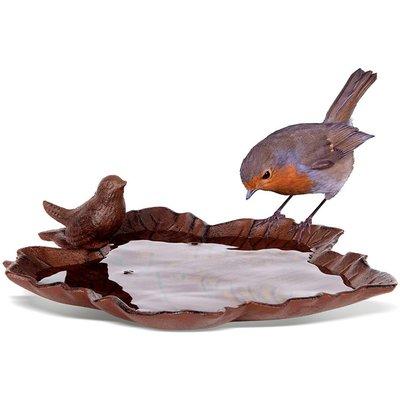 Old iron bird bath