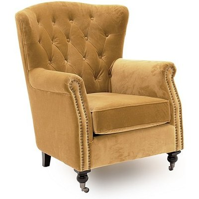 Reedy Velvet Wingback Chair In Mustard With Metal Castor