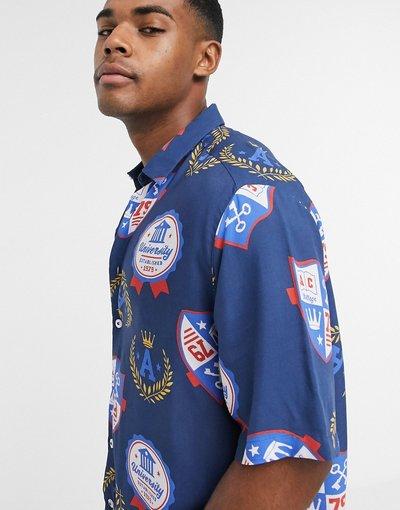 Camicia Navy uomo Camicia vestibilità classica con stampa stile college americano - ASOS DESIGN - Navy