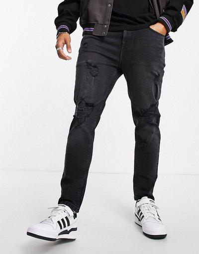Jeans Nero uomo Jeans affusolati nero slavato con strappi vistosi - ASOS DESIGN