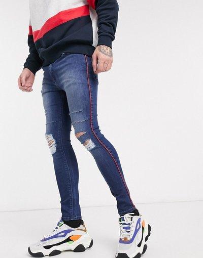 Jeans Blu uomo Jeans in denim power stretch effetto spray con riga laterale e strappi vistosi - ASOS DESIGN - Blu