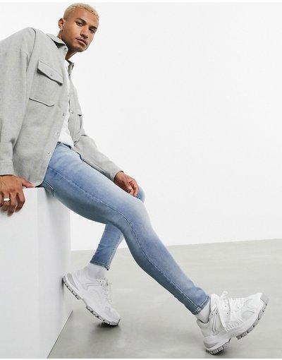 Jeans Blu uomo Jeans in power stretch blu polvere chiaro effetto spray - ASOS DESIGN