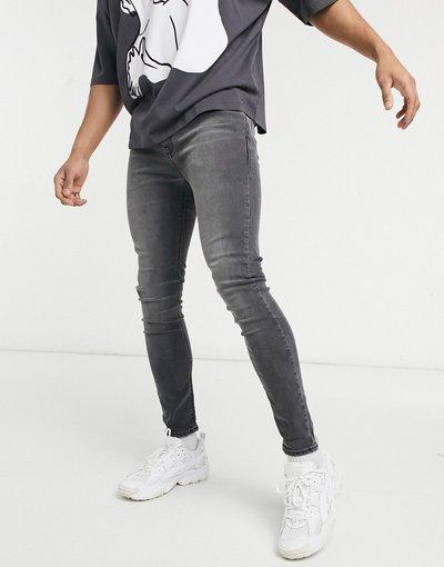 Jeans Nero uomo Jeans in power stretch nero slavato effetto spray - ASOS DESIGN