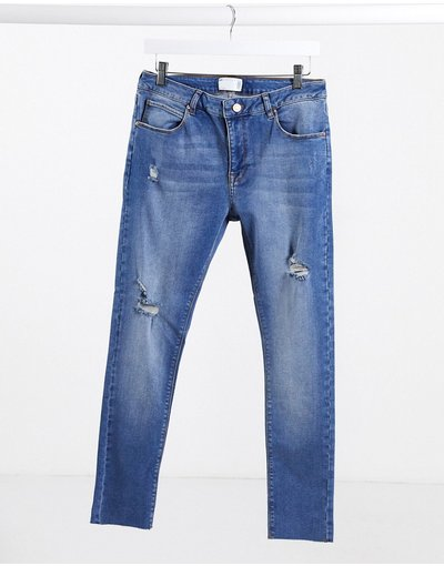 Jeans Blu uomo Jeans power stretch lavaggio blu medio effetto spray con abrasioni e fondo grezzo - ASOS DESIGN