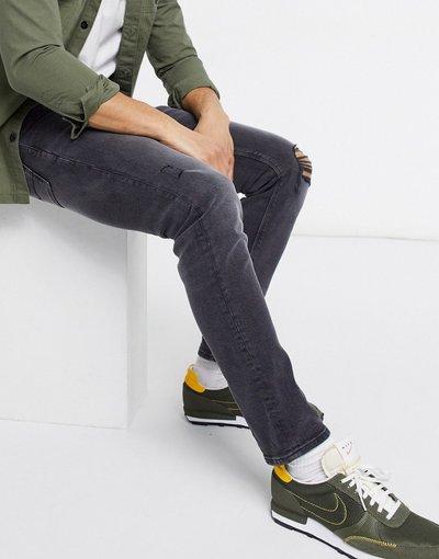 Jeans Nero uomo Jeans slim elasticizzati nero slavato con strappi sulle ginocchia e abrasioni - ASOS DESIGN