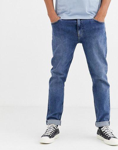 Jeans Blu uomo Jeans stretch affusolati lavaggio blu medio piatto - ASOS DESIGN