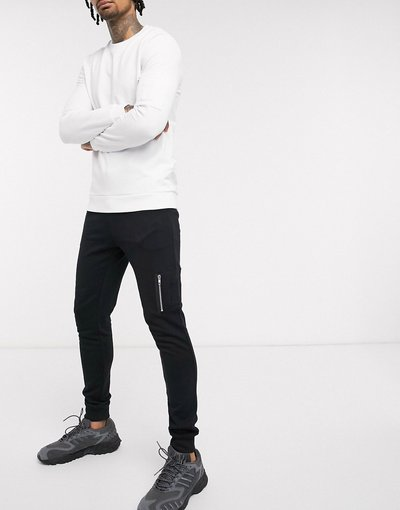 Pantalone Nero uomo Joggers skinny in tessuto organico con tasca MA1 neri - ASOS DESIGN - Nero