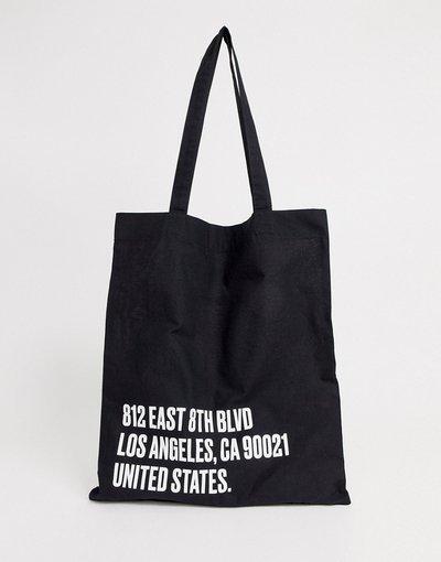 Borsa Nero uomo Maxi borsa in tessuto organico nero con scritta bianca - ASOS DESIGN