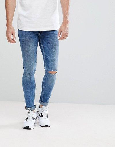 Jeans Blu uomo Jeans extreme skinny lavaggio medio vintage con strappi alle ginocchia - ASOS - Blu