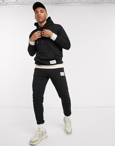 Novita Nero uomo Tuta sportiva con cappuccio e stampaMannera con bordi a coste a contrasto - boohooMAN - Nero