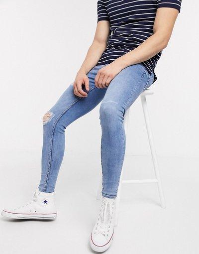 Jeans Blu uomo Jeans strappati effetto spray lavaggio blu medio - New Look