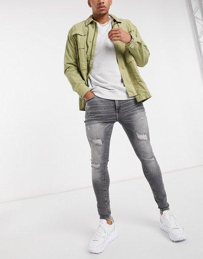 Jeans Grigio uomo Jeans grigi strappati effetto spray - River Island - Grigio