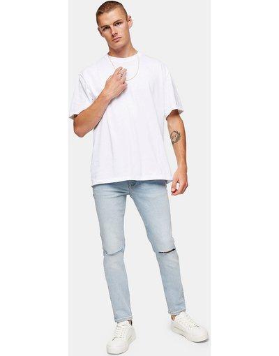 Jeans Blu uomo Jeans skinny elasticizzati con strappi sulle ginocchia candeggiati - Topman - Blu