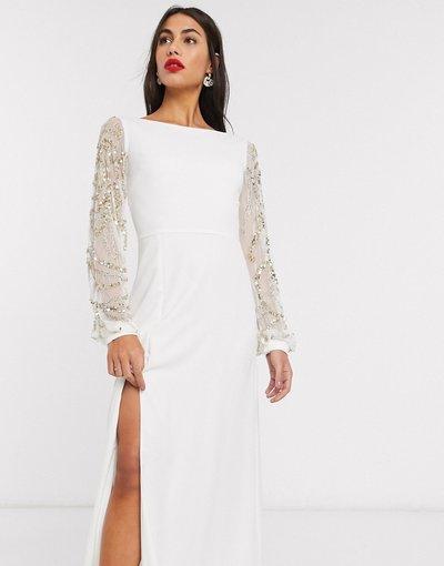 Eleganti lunghi Crema donna Vestito lungo color crema con maniche lunghe trasparenti e spacco sulla coscia - Virgos Lounge