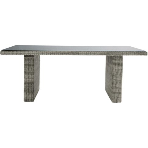 Tempered glass and resin wicker garden table in grey...