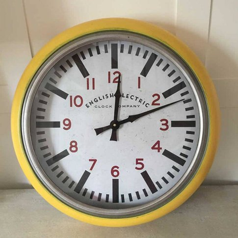 Round Yellow Metropolitan Distressed Metal Wall Clock