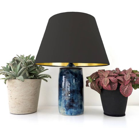 Conical Shaped Lampshade With A Metallic Lining