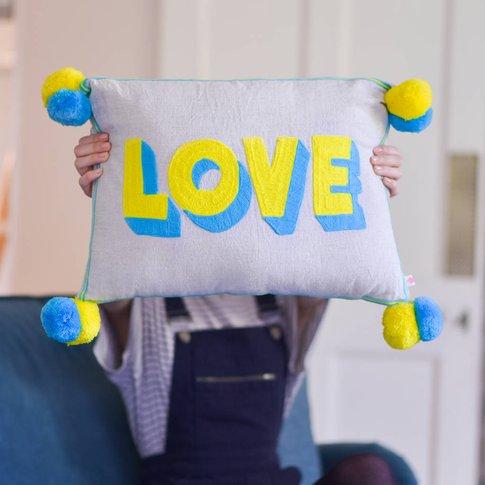 Embroidered 'Love' Pom Pom Cushion