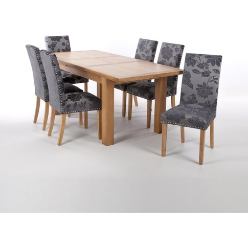Solid Oak Extendable Dining Table With 8 Stud Detail...