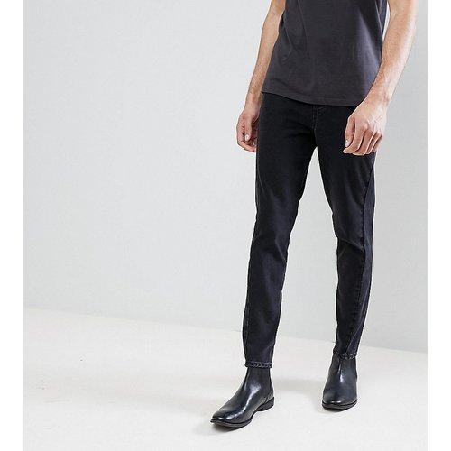 Jeans im Sale - ASOS DESIGN - Tall - Enge Jeans in Schwarz mit gedrehten Säumen - Schwarz