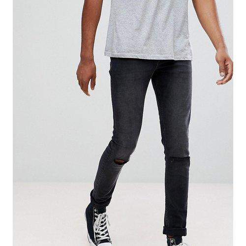 Jeans Sale - ASOS TALL - Superenge Skinny-Jeans in verwaschenem Schwarz mit Zierrissen an den Knien