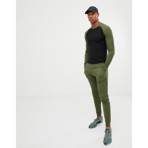 Sweatshirt & Hoodie Sale - ASOS DESIGN - Trainingsanzug mit Muskel-Sweatshirt mit kontrastierenden Raglanärmeln und enger Jogginghose in Grün - Schwarz