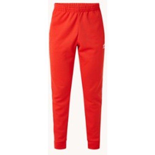 Pantalon de jogging coupe fuselée avec poches zippées - Adidas - Modalova