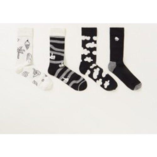 Chaussettes et blanches avec motif dans un coffret cadeau de 4 - Happy Socks - Modalova