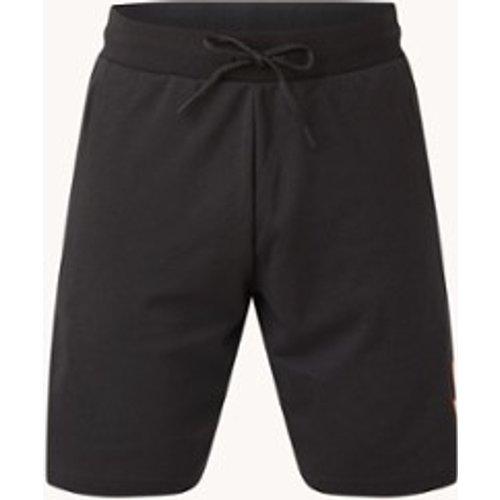 Short d'entraînement coupe droite avec logo imprimé et poches zippées - Adidas - Modalova