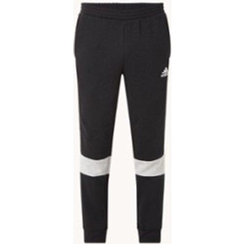 Pantalon de jogging taille haute coupe fuselée avec poches latérales - Adidas - Modalova