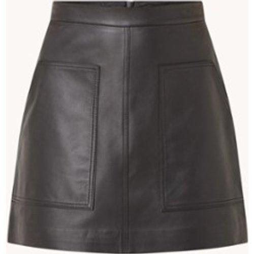 Mini-jupe en cuir Eliza avec poches latérales - Ted Baker - Modalova