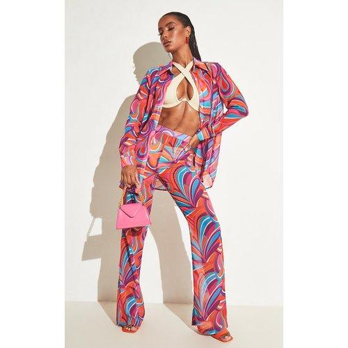 Pantalon de plage flare en mousseline de soie imprimé - PrettyLittleThing - Modalova