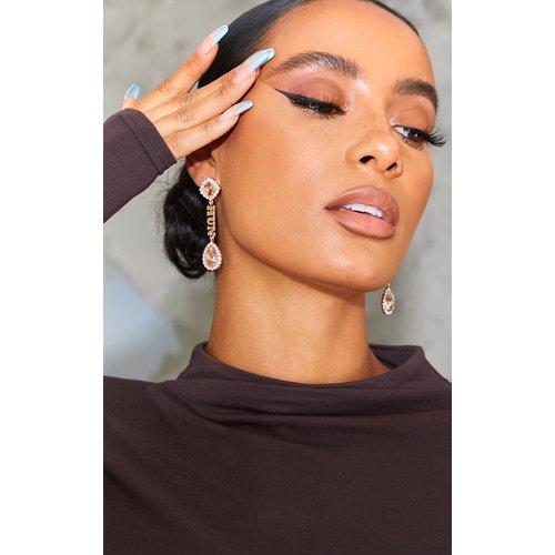 Boucles d'oreilles pendantes à slogan Hun et pierres - PrettyLittleThing - Modalova