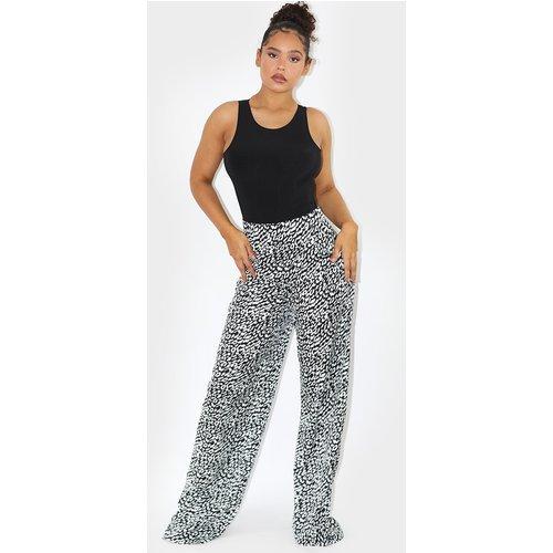 Pantalon évasé noir imprimé  - PrettyLittleThing - Modalova