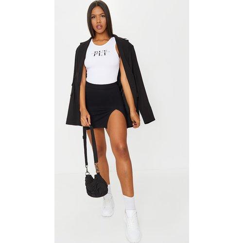 Mini-jupe fendue en jersey - PrettyLittleThing - Modalova