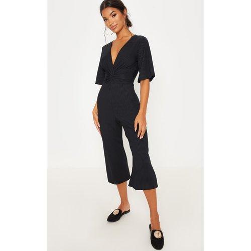 Combinaison côtelée style jupe-culotte à devant torsadé - PrettyLittleThing - Modalova