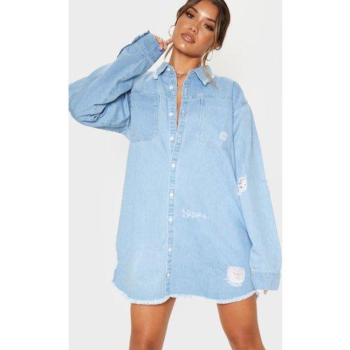 Robe chemise déchirée en jean bleu délavé - PrettyLittleThing - Modalova