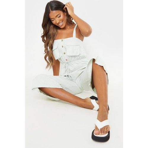Combinaison jupe-culotte à bretelles nouées et poches détail rayures - PrettyLittleThing - Modalova
