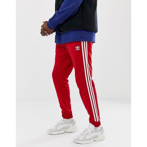 DV1534 - Pantalon de jogging ajusté à 3 bandes resserré aux chevilles - adidas Originals - Modalova