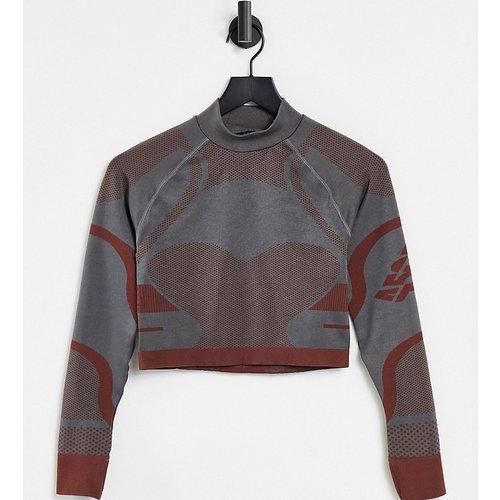 Petite - Top de sous-vêtement à manches longues et empiècements marqués sans coutures - ASOS 4505 - Modalova