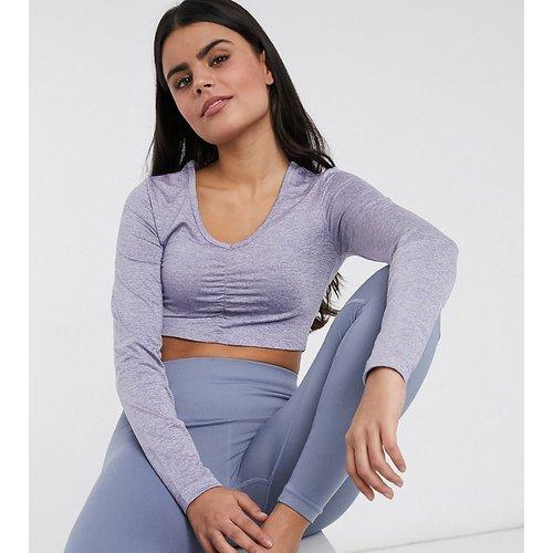 Petite - Top de yoga à manches longues froncé sur le devant - ASOS 4505 - Modalova