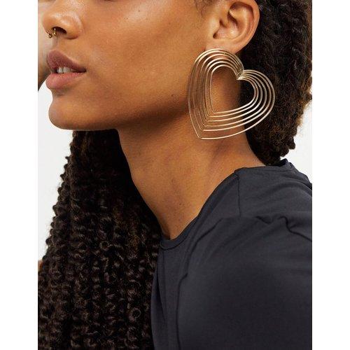 Boucles d'oreilles avec cœurs en métal - Couleur or - ASOS DESIGN - Modalova