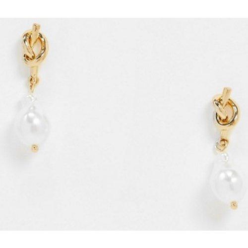 Boucles d'oreilles avec nœud et perle - ASOS DESIGN - Modalova