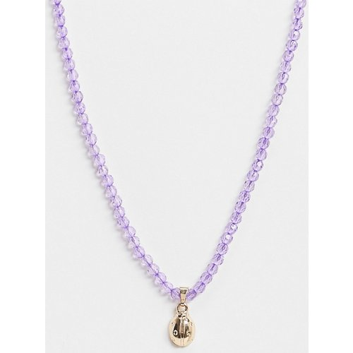 Collier avec perles violettes et pendentif coccinelle - ASOS DESIGN - Modalova