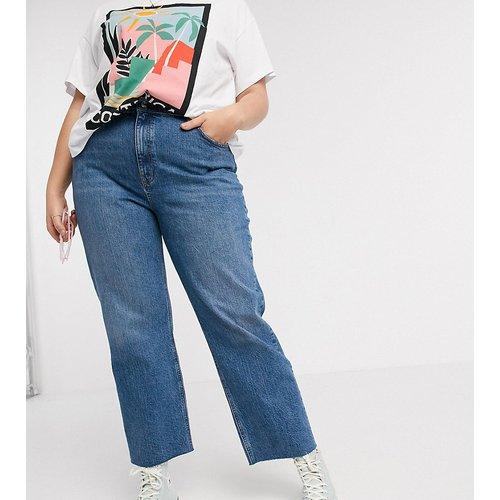 ASOS DESIGN Curve-Effortless - Jean stretch évasé taille haute coupe courte - Délavagenoir moyen - ASOS Curve - Modalova