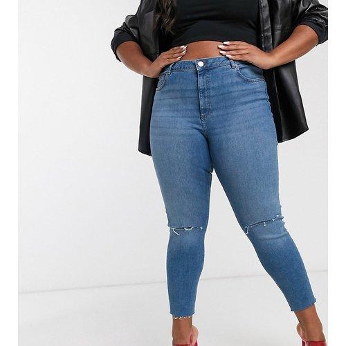 ASOS DESIGN Curve - Ridley - Jean skinny taille haute à déchirures - délavé moyen - ASOS Curve - Modalova
