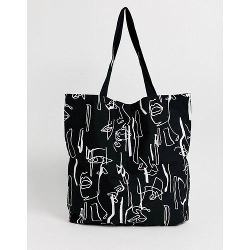 Grand cabas en coton à imprimé visage abstrait - ASOS DESIGN - Modalova